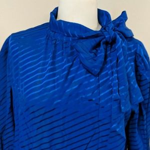 Blue ysl silk blouse, ties at neck.